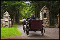 Carriage passing through carriage road gate. Acadia National Park, Maine, USA.
