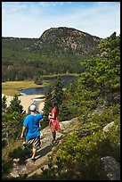 Hikers above Sand Beach. Acadia National Park, Maine, USA.