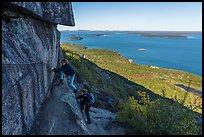 Hikers on ledge with handrails, Precipice Trail. Acadia National Park ( color)