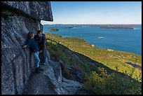 Hikers resting on ledge with handrails. Acadia National Park ( color)