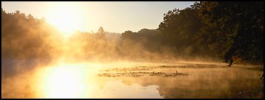 Sun rising above misty lake at dawn. Cuyahoga Valley National Park (Panoramic color)