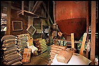 Grain distributor and bags of seeds in Wilson Mill. Cuyahoga Valley National Park ( color)