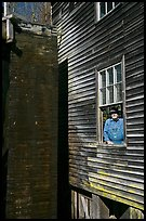 Miller standing at window, Mingus Mill, North Carolina. Great Smoky Mountains National Park, USA. (color)