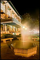 Fountain with thermal steam outside Fordyce Bath at night. Hot Springs National Park ( color)