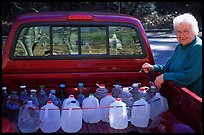 Resident stocks up on natural spring water. Hot Springs National Park ( color)