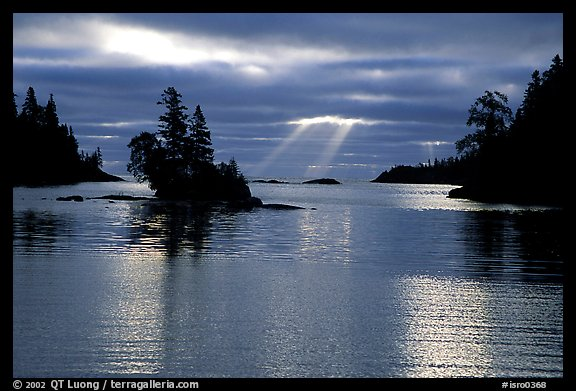Sunrays and islet,  Chippewa harbor. Isle Royale National Park, Michigan, USA.