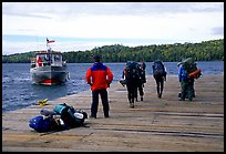 Backpackers waiting for pick-up by the ferry at Windego. Isle Royale National Park ( color)