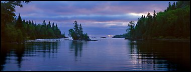 Cloudy sunrise on north woods lake. Isle Royale National Park (Panoramic color)