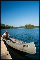 Canoist at dock, Tobin Harbor. Isle Royale National Park ( color)