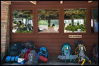 Backpacks lined behind visitor center, Rock Harbor. Isle Royale National Park ( color)