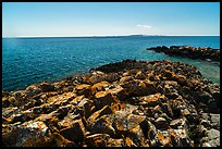 Lichen-covered rocks, Lake Superior, and Isle Royale from Passage Island. Isle Royale National Park ( color)
