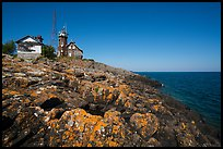 Lichen-covered rocks and Lighthouse, Passage Island. Isle Royale National Park ( color)