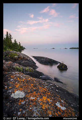 Lichen-colored rocks on Rock Harbor shore, sunset. Isle Royale National Park (color)