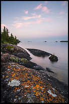Lichen-colored rocks on Rock Harbor shore, sunset. Isle Royale National Park ( color)