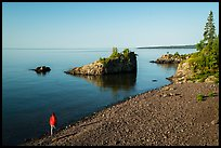 Visitor looking, Mott Island. Isle Royale National Park ( color)