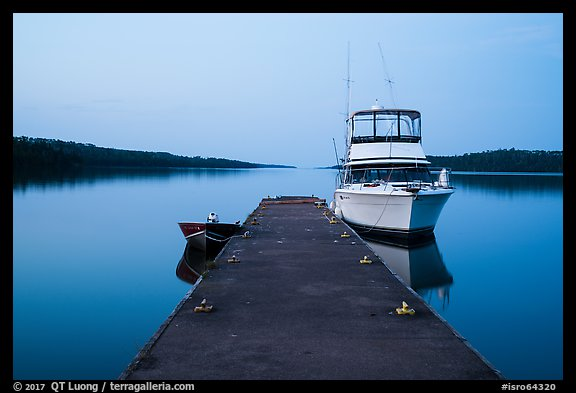 Dock with motorboat and yacht at dusk, Moskey Basin. Isle Royale National Park (color)