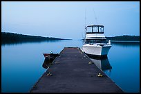 Dock with motorboat and yacht at dusk, Moskey Basin. Isle Royale National Park ( color)