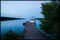 Moskey Basin dock with motorboat and ycaht, dusk. Isle Royale National Park ( color)