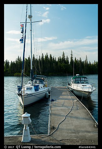 Sailboat and motorboat moored at Rock Harbor. Isle Royale National Park (color)