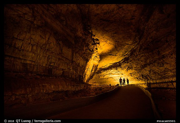 Family backlighted in dark cave corridor. Mammoth Cave National Park (color)