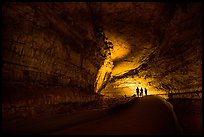 Family backlighted in dark cave corridor. Mammoth Cave National Park ( color)