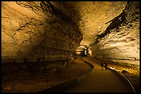 Couple walking down path in cave. Mammoth Cave National Park ( color)
