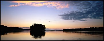 North woods tree-overed isled at sunset. Voyageurs National Park (Panoramic color)