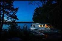 Houseboat lit from within at night, Sand Point Lake. Voyageurs National Park ( color)