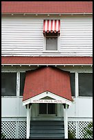 Kettle Falls Hotel door and window with red and white stripes awning. Voyageurs National Park ( color)