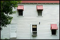 Kettle Falls Hotel wall with with red and white stripes awnings. Voyageurs National Park ( color)