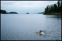 Man swimming, Anderson Bay. Voyageurs National Park ( color)