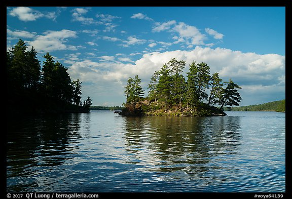 North Woods islet and reflection, Sand Point Lake. Voyageurs National Park (color)
