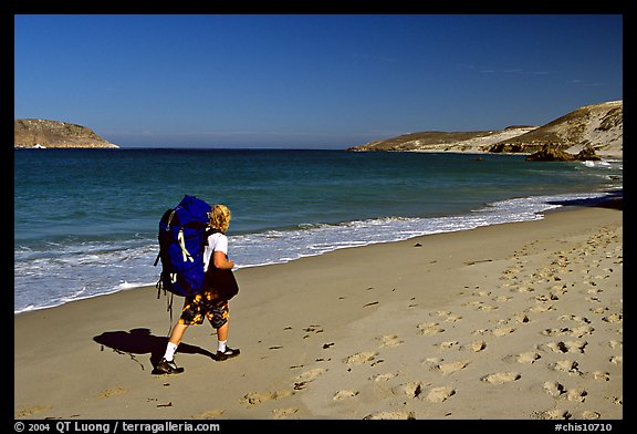 Backpacker on beach, Cuyler harbor, San Miguel Island. Channel Islands National Park, California, USA.