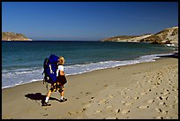 Backpacker on beach, Cuyler harbor, San Miguel Island. Channel Islands National Park ( color)
