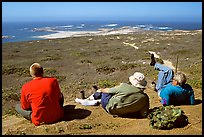 Hikers observing Point Bennett from a distance, San Miguel Island. Channel Islands National Park ( color)