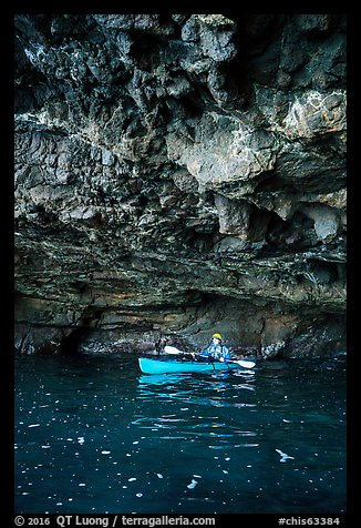 Kayaker in sea cave with low ceiling, Santa Cruz Island. Channel Islands National Park (color)