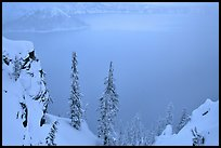 Trees and mistly lake in winter. Crater Lake National Park ( color)