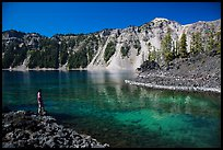 Visitor looking, Fumarole Bay, Wizard Island. Crater Lake National Park ( color)