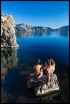 Men sunning on rock, Cleetwood Cove. Crater Lake National Park ( color)