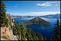 Visitor looking, Wizard Island and lake. Crater Lake National Park ( color)