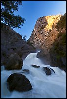 Roaring River Falls below high granite cliff. Kings Canyon National Park, California, USA.