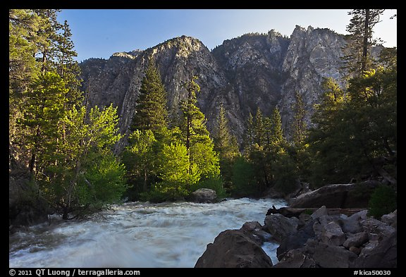 Rushing river and trees, and cliff in spring. Kings Canyon National Park (color)