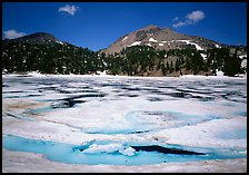 Helen Lake with Ice breaking up, and Lassen Peak. Lassen Volcanic National Park, California, USA. (color)