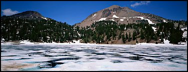 Melting ice in lake and Lassen Peak. Lassen Volcanic National Park (Panoramic color)