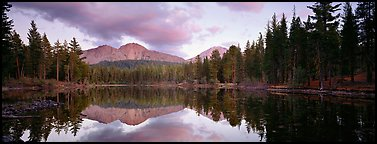 Volcanic peak and conifer reflected in lake. Lassen Volcanic National Park (Panoramic color)