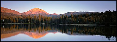Lassen Peak reflected in Manzanita lake at sunset. Lassen Volcanic National Park (Panoramic color)