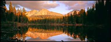 Chaos Crags reflected in lake at sunset. Lassen Volcanic National Park (Panoramic color)