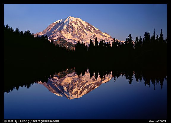 Mount Rainier with calm reflection in Eunice Lake, sunset. Mount Rainier National Park, Washington, USA.