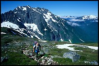 Mountaineer hiking on the way to Sahale Peak,  North Cascades National Park.  ( color)