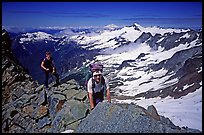 Mountaineers on ridge below  summit of Sahale Peak, North Cascades National Park.  ( color)